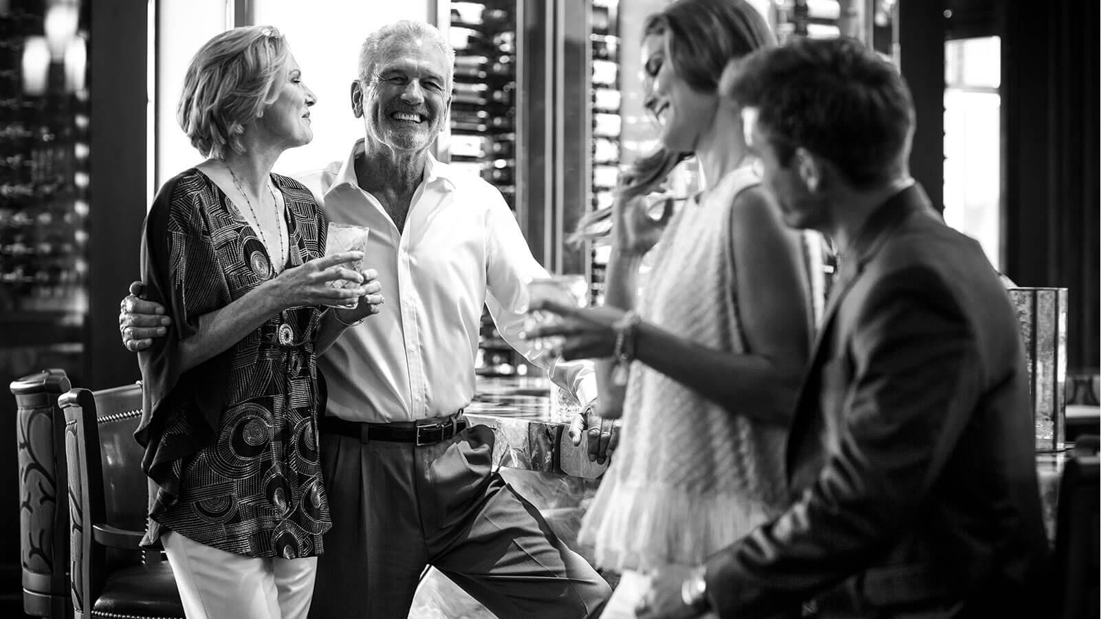 Two couples laughing